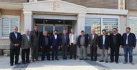 Defneli muhtarlar MHP'yi ziyaret etti