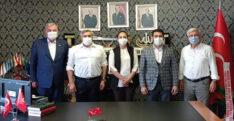 AK PARTİ HEYETİNDEN MHP İL BAŞKANI MURAT ADAL'A ZİYARET